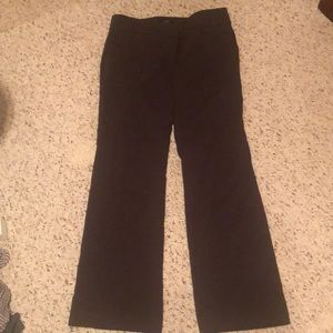 Dark olive trousers that flare with pockets